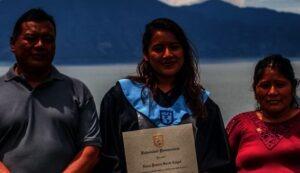 A University graduate with her parents in Panajachel